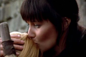 Smooches for Gabrielle. Because Xena doesn't know what is coming.